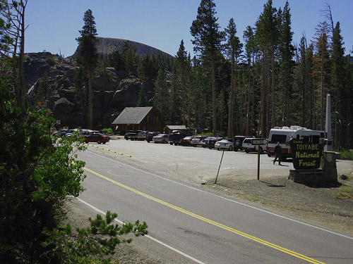 approaching Carson Pass cabin, parking lot, and historical monument. Northbound on PCT. Elephant Back in background.