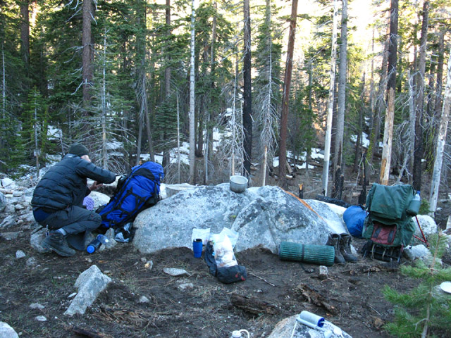 Ari getting campsite together just below snowline, Meiss Country Roadless Area, backpacking Lake Tahoe