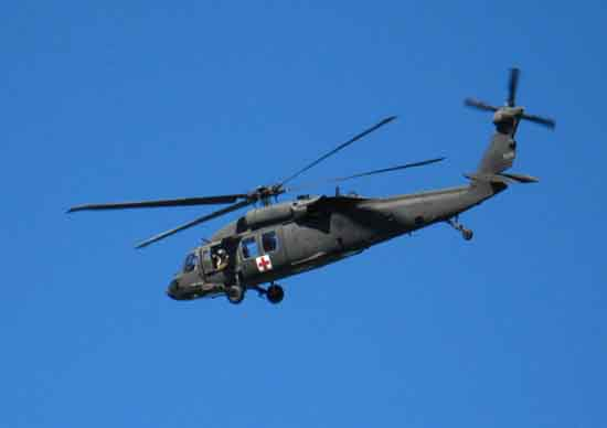 Army Reserve Rescue Blackhawk carrying hiker & Alpine County SAR dude.