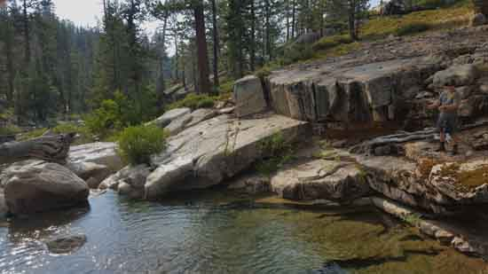 Johnny and pal fishing Highland Creek in the Stanislaus National Forest.