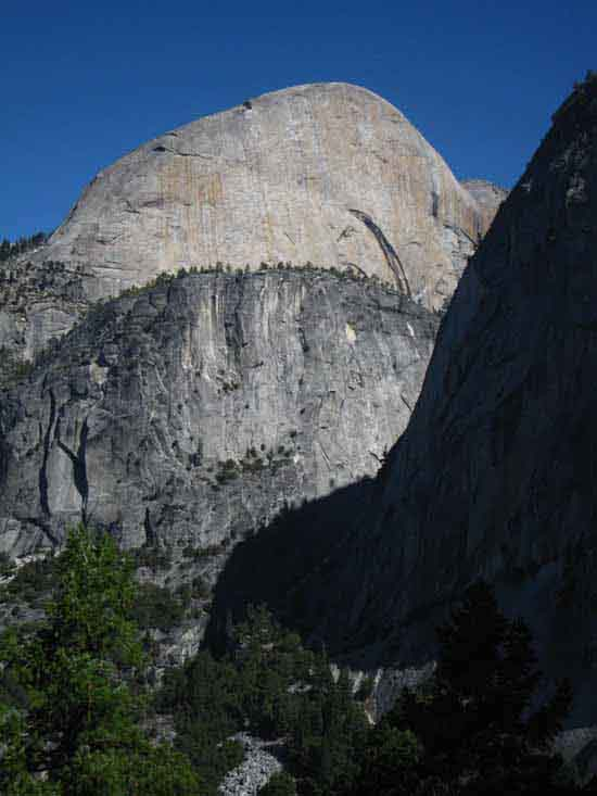 Liberty Cap in Shadows with Half Dome towering over Mount Broderick.
