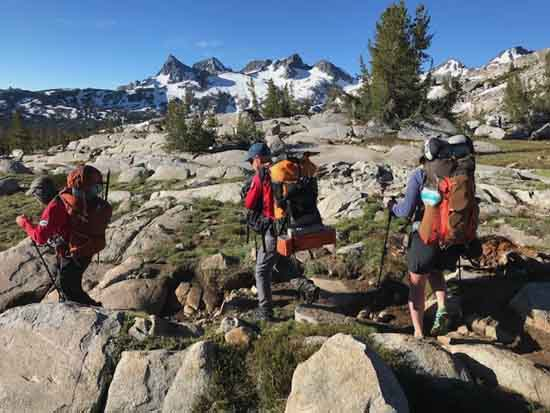 MONO SAR hiking South of Donohue Pass with Minarets, Banner & Ritter to their South, image by J. Bush.
