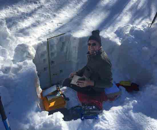 "Measuring snowpack in a ""snow pit"" along Arizona's Mogollon Rim during a snow survey in 2017. Credit Patrick Broxton, copyright 2017."