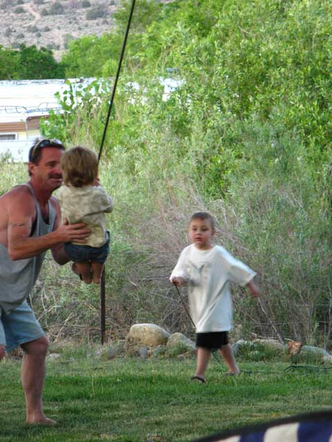 Steve introducing swinging fun to a little one.