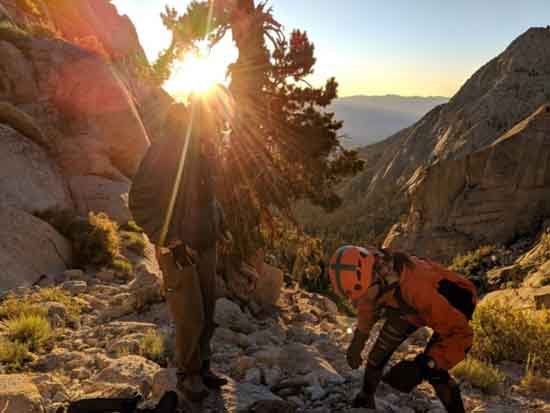 INYO SAR rescue up Whitney Mountaineer's Route gorge as sun sets.
